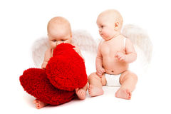Baby angels. Two angelic baby friends in white diapers Stock Images