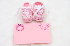 Baby Announcement. Baby booties with a blank card sitting on a white background, Baby Announcement Royalty Free Stock Photography