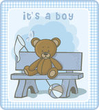 Baby announcement card. Vector illustration depicting a teddy bear sitting on a bench Royalty Free Stock Photo