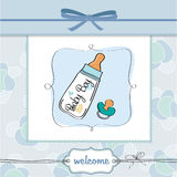 Baby announcement card with milk bottle. And pacifier Stock Photos