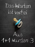 Baby Announcement with german Text and Pacifier Stock Images