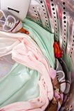 Baby apparel in washing machine. Inside view of washing machine containing baby apparel stock image
