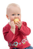 Baby with an apple. Little girl holding an apple Royalty Free Stock Image