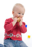 Baby with apple. Little girl holding an apple Royalty Free Stock Photography