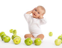 Baby with apple. Child with apple isolated on white Royalty Free Stock Images