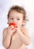 Baby and apple. Baby eating apple at home Royalty Free Stock Photography