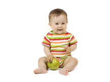 Baby with the apple Stock Image