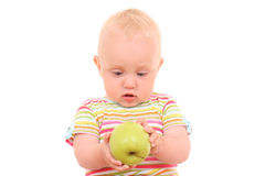 Baby and apple stock image
