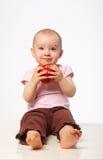 Baby with apple stock photo