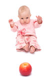 Baby and the apple. Lovely baby is looking surprised at the apple Royalty Free Stock Photos
