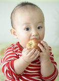 Baby and apple Stock Photos