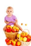 Baby on apple heap Stock Image