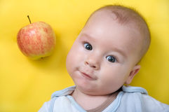Baby with apple Royalty Free Stock Image