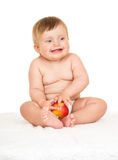 Baby with apple sit on towel Royalty Free Stock Images