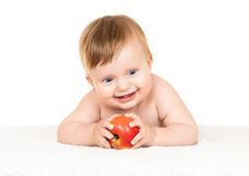 Baby with apple Stock Photos
