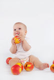 Baby with apples Stock Images