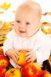Baby with apples Stock Image
