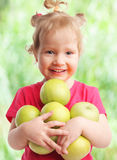 Baby with apples Stock Photos