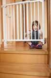 Baby approaching safety gate Royalty Free Stock Photo