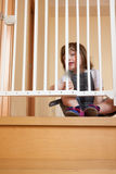 Baby approaching safety gate Stock Images