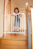 Baby approaching safety gate of  stairs Royalty Free Stock Photos