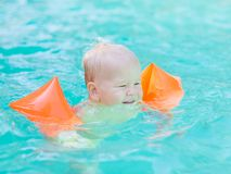 Baby with armbands Stock Photos