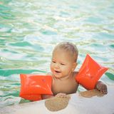 Baby with armbands Royalty Free Stock Photography