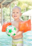 Baby with armbands Royalty Free Stock Image