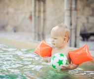 Baby with armbands Royalty Free Stock Photos