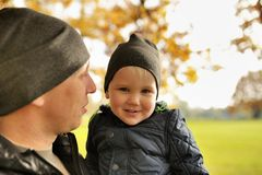 Baby on arms of his father in park.  royalty free stock images