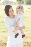 Baby in arms and mother Royalty Free Stock Images