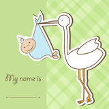 Baby arrival card with stork. That brings a cute boy Royalty Free Stock Photography