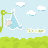 Baby arrival card with stork that brings a cute. Boy Royalty Free Stock Image