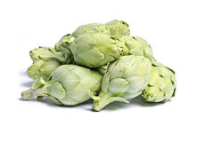 Baby Artichokes. Pile of baby artichokes isolated on white Royalty Free Stock Photos