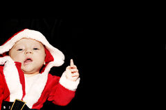 Baby as father christmas. A cute baby dressed up as father christmas Stock Photos