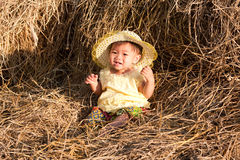 Baby of Asia sits in straw Stock Image