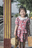 Baby Asian girl while waiting for train. Stock Photo