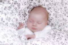 Baby asleep in a bed Royalty Free Stock Photos