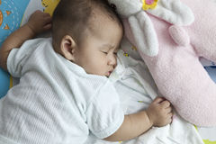 Baby asleep on bed. File of baby asleep on bed Royalty Free Stock Image