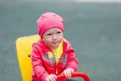 Baby auf seasaw Stockbilder