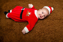 Baby auf seinem ersten Weihnachten Stockbilder