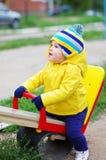 Baby auf Spielplatz Stockbilder