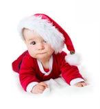 Baby auf weißem Hintergrund in Sankt-Kostüm Lizenzfreies Stockbild
