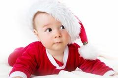 Baby auf weißem Hintergrund in Sankt-Kostüm Lizenzfreie Stockbilder