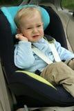 Baby in autozetel Stock Foto
