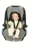 Baby in autozetel Stock Foto's