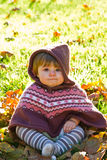 Baby with autumn leaf Stock Image