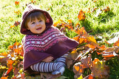 Baby with autumn leaf. Smiling baby with autumn leaf Royalty Free Stock Images