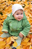 Baby in autumn leaves Royalty Free Stock Photos