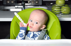 Baby awaiting lunch Stock Images